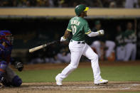 Oakland Athletics' Marcus Semien watches his RBI double off Texas Rangers' Mike Minor in the fourth inning of a baseball game Friday, Sept. 20, 2019, in Oakland, Calif. (AP Photo/Ben Margot)
