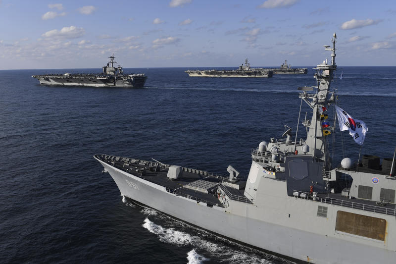 In this Nov. 12, 2017 photo provided by South Korea Defense Ministry, three U.S. aircraft carriers USS Theodore Roosevelt, top left, USS Ronald Reagan, top center, and USS Nimitz, top right, participate with South Korean Navy's Aegis destroyer, King Sejong the Great, bottom, during the joint naval exercises between the United States and South Korea in waters off South Korea's eastern coast in South Korea. The United States and South Korea on Saturday started joint naval exercises that will involve three U.S. aircraft carriers in what military officials describe as a clear warning to North Korea. (South Korea Defense Ministry via AP)
