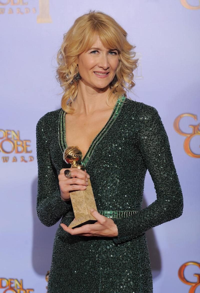 "FILE - In this Jan. 15, 2013 file photo, actress Laura Dern poses backstage with the award for Best Actress in a TV Series, Comedy or Musical for the TV series "" Enlightened"" during the 69th Annual Golden Globe Awards, in Los Angeles. HBO says Dern's series ""Enlightened"" isn't coming back for a third season. In a statement Tuesday, March 19, 2013, the premium cable channel said it was proud of the show, and called canceling it a ""very difficult decision."" (AP Photo/Mark J. Terrill, file)"
