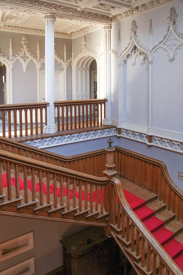 <p>Among the castle's most striking features is this top-lit staircase and numerous doors painstakingly fashioned from carved oak. (LeadingEstates.com) </p>
