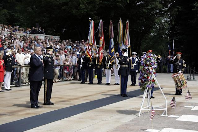 <p>President Donald Trump stands during the playing of Taps after laying a wreath at The Tomb of the Unknown Solider at Arlington National Cemetery, Monday, May 29, 2017, in Arlington, Va. (Photo: Evan Vucci/AP) </p>