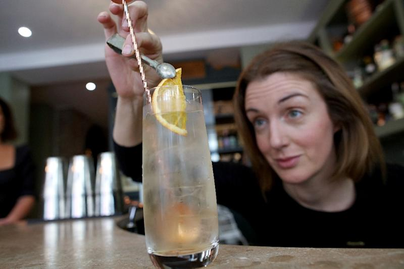 Bar manager Anna Walsh said before The Virgin Mary no-alcohol pub opened, they did not know if it would be able to create the same atmosphere as a traditional pub. But once the pub had filled up, there was no difference (AFP Photo/PAUL FAITH)