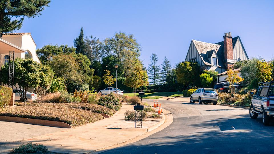 Street in the residential area of Oakland on a sunny autumn day, San Francisco bay area, California.