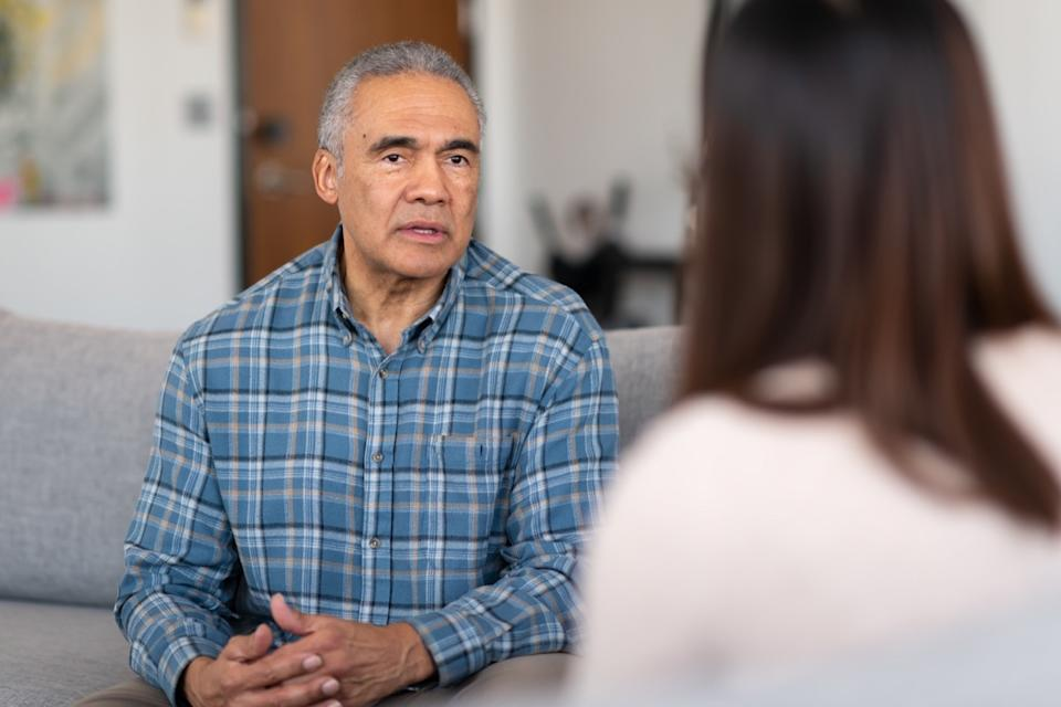 man talks to a therapist about his marriage. He is serious about working on his relationship with his wife.