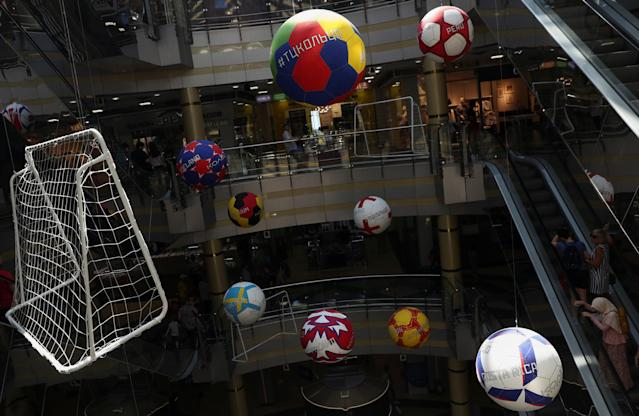 Giant soccer ball and goal decorations hang inside a shopping mall in Kazan, Russia, June 24, 2018. As well as shooting all the matches, Reuters photographers are producing pictures showing their own quirky view from the sidelines of the World Cup. REUTERS/Sergio Perez