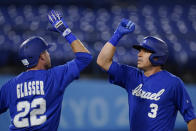 Israel's Ian Kinsler (3) celebrates with Mitchell Glasser after hitting a home run in the third inning of a baseball game against South Korea at the 2020 Summer Olympics, Thursday, July 29, 2021, in Yokohama, Japan. (AP Photo/Sue Ogrocki)