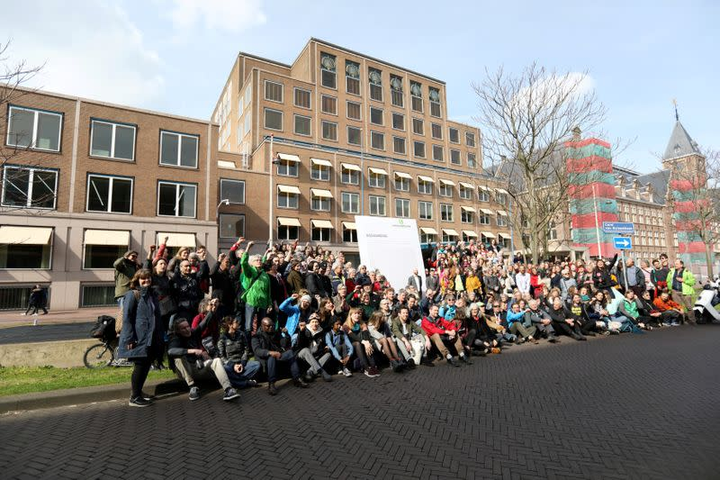 FILE PHOTO: Environmentalist and human rights groups demand Royal Dutch Shell to stop the extraction of oil and gas, outside of its headquarters in The Hague