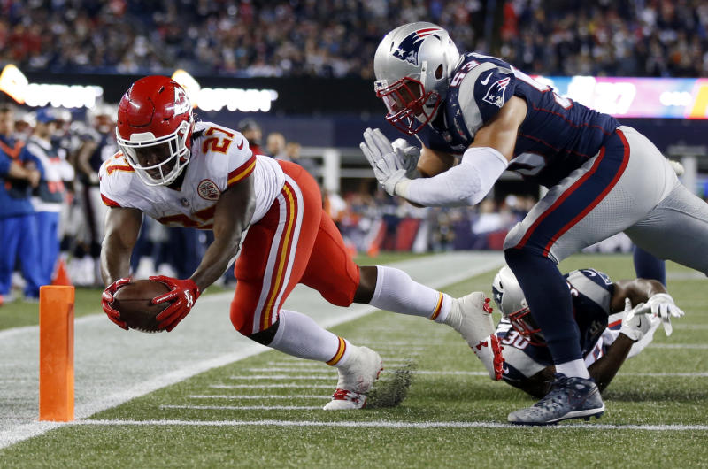 Kareem Hunt rushes for one of his three total touchdowns on Thursday. (AP)