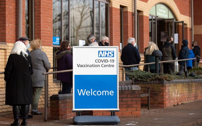 Queues for the Covid-19 vaccine at the mass vaccination hub at Robertson House in Stevenage, north of London - Joe Giddens/AFP