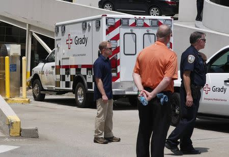 An ambulance carrying American missionary Writebol, who is infected with Ebola in West Africa, arrives at Emory University Hospital in Atlanta
