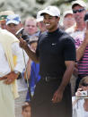 <p>Tiger Woods smiles on the putting green during practice for the 2007 Masters golf tournament at the Augusta National Golf Club in Augusta, Ga., Wednesday, April 4, 2007. First round play begins on Thursday. (AP Photo/Chris O'Meara) </p>