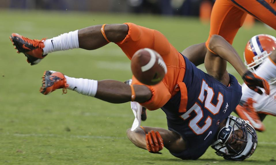 Virginia cornerback DreQuan Hoskey (22) gets upended on an incomplete pass during the first half of an NCAA college football game against Clemson in Charlottesville, Va., Saturday, Nov. 2, 2013. (AP Photo/Steve Helber)