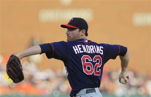 Minnesota Twins starting pitcher Liam Hendriks throws during the first inning of a baseball game against the Detroit Tigers in Detroit, Monday, July 2, 2012. (AP Photo/Carlos Osorio)