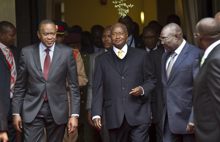 """FILE - In this Wednesday, July 31, 2013, file photo, Kenya's President Uhuru Kenyatta, left, Uganda's President Yoweri Museveni, center, and the transitional leader of the Central African Republic Michel Djotodia, right, arrive for the Special Summit of the International Conference on the Great Lakes Region (ICGLR) held at the United Nations Office in Nairobi, Kenya. Ugandan President Yoweri Museveni met in his office with a team of U.S.-based rights activists concerned about legislation that would impose life sentences for some homosexual acts and made clear he had no plans to sign the bill, according to Santiago Canton of the Robert F. Kennedy Center for Justice and Human Rights who attended the Jan. 18, 2014 meeting, but one month later Museveni appears to have changed his mind, saying through a spokesman in February 2014 that he would sign the bill """"to protect Ugandans from social deviants."""" (AP Photo/Ben Curtis, File)"""