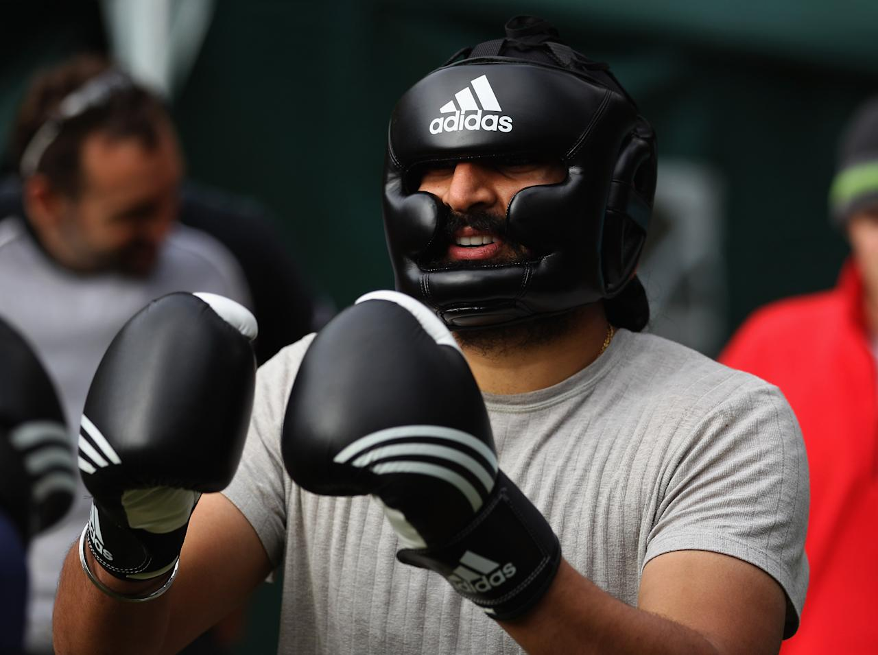 NUREMBERG, GERMANY - SEPTEMBER 26:  England player Monty Panesar prepares before a bout in the boxing excercise during the England Cricket squad Pre Ashes Training Camp on September 26, 2010 near Nuremberg, Germany.  (Photo by Stu Forster/Getty Images)