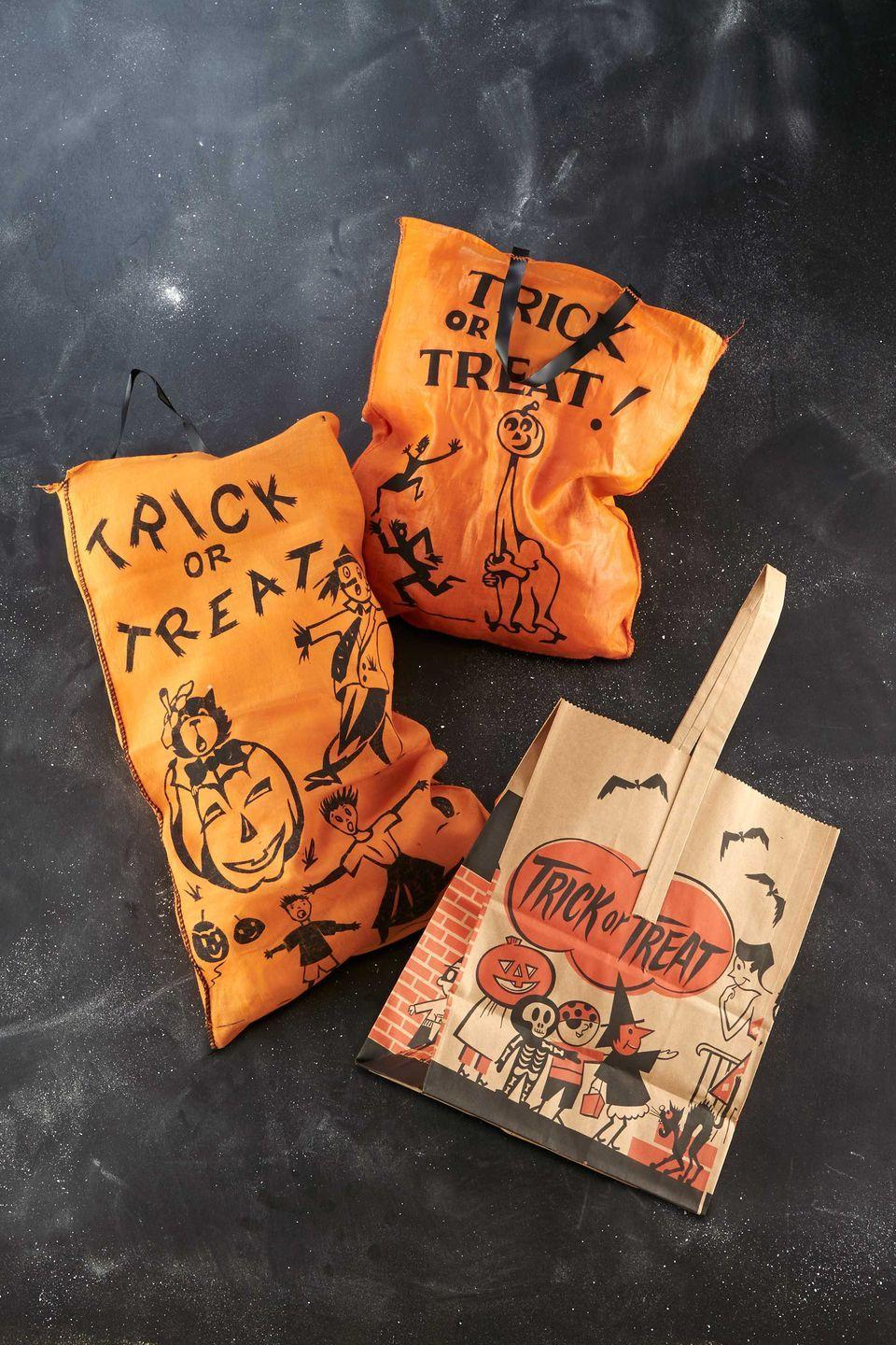 """<p>Midcentury paper trick-or-treat bags sold for pennies at the local five-and-dime, as folks would later fill them with Bazooka Joe, Tootsie Pops, and Baby Ruths. """"These days, expect to pay about $30 for a 1950s sack with a simple image, such as a jack-o'-lantern,"""" says Bruce Elsass, one of the nation's preeminent collectors of Halloween accessories. </p>"""