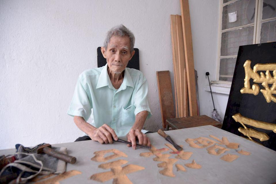 At 83, Kok Ah Wah can still carve a traditional signboard. — Pix by Steven Ooi KE