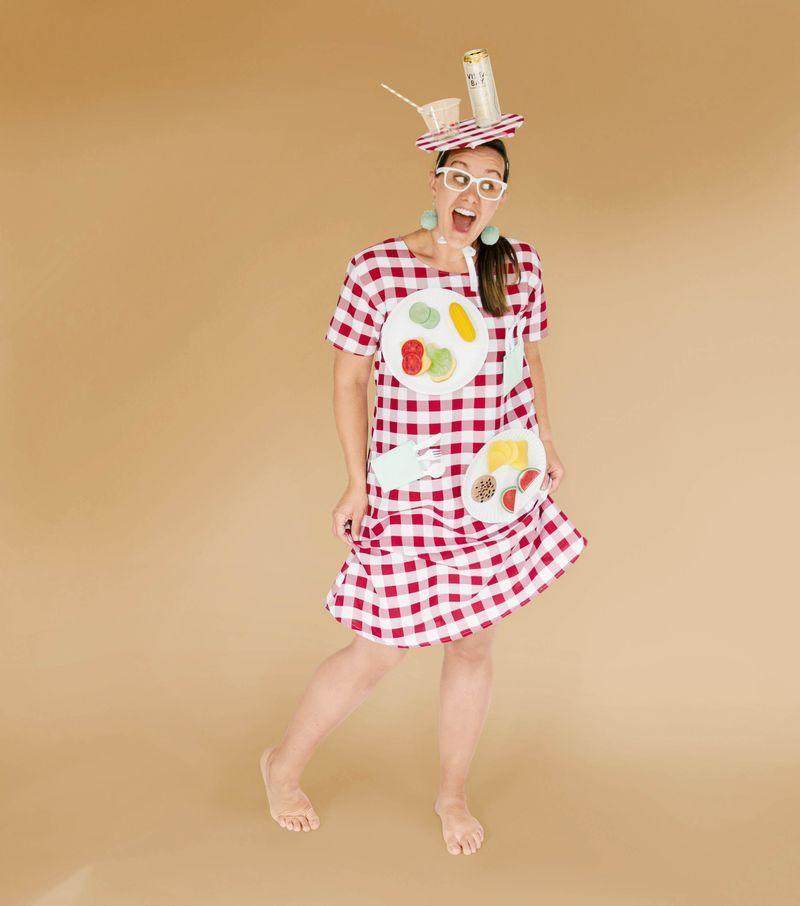 """<p>Fashion a dress from red-and-white gingham fabric (or simply buy one), and embellish it with paper plates, kids' faux foods, and utensils. (Add plastic ants, if desired!) A fascinator made from a paper-covered cardboard disc and more picnic fixin's furthers this feast for the eyes.</p><p><strong>Get the tutorial at <a href=""""https://ohyaystudio.com/a-diy-picnic-table-costume-an-homage-to-my-creative-mom/"""" rel=""""nofollow noopener"""" target=""""_blank"""" data-ylk=""""slk:Oh Yay Studio"""" class=""""link rapid-noclick-resp""""><strong>Oh Yay Studio</strong></a>.</strong></p>"""