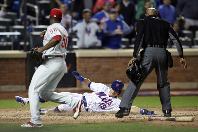 New York Mets' Sam Haggerty (19) scores past Philadelphia Phillies relief pitcher Hector Neris (50) on an RBI-single by Pete Alonso during the eighth inning of a baseball game Friday, Sept. 6, 2019, in New York. (AP Photo/Mary Altaffer)