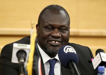 South Sudan's rebel leader Riek Machar prepares to address a news conference during the peace signing meeting in Ethiopia's capital Addis Ababa