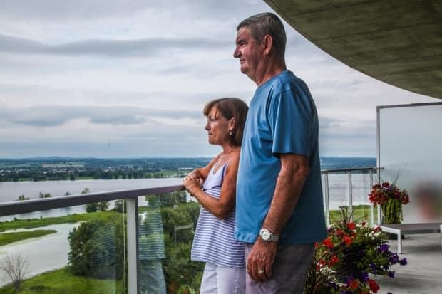 Daniel Raymond and Renée Larose-Raymond say the cabins are a threat to the sensitive wetlands that make up Petrie Island. (Stu Mills/CBC - image credit)