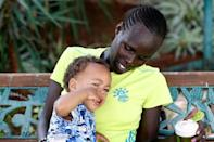 Lonah Chemtai, a Kenyan-born runner who will represent Israel in the women's marathon at the 2016 Rio Olympics, looks at her 19 month-old son, Roy Salpeter, after training with her husband and coach, Israeli Dan Salpeter, near their house in Moshav Yanuv, central Israel July 14, 2016. REUTERS/Baz Ratner