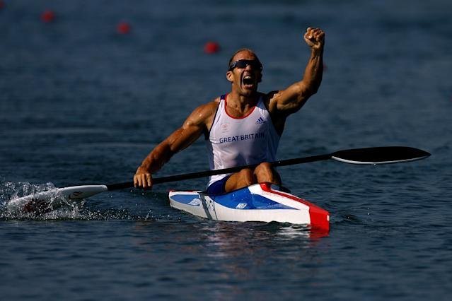 BEIJING - AUGUST 22: Tim Brabants of Great Britain celebrates winning the gold medal in the men's flatwater kayak single (K1) 1000m Men Final at the Shunyi Olympic Rowing-Canoeing Park on Day 14 of the Beijing 2008 Olympic Games on August 22, 2008 in Beijing, China. (Photo by Jeff Gross/Getty Images)