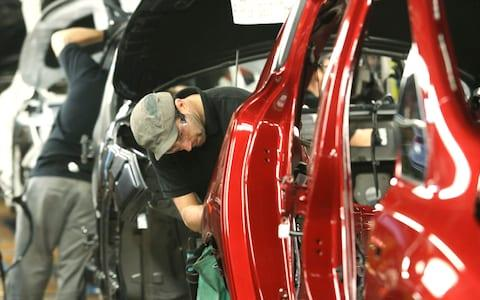 Nissan production line - Credit: Bloomberg