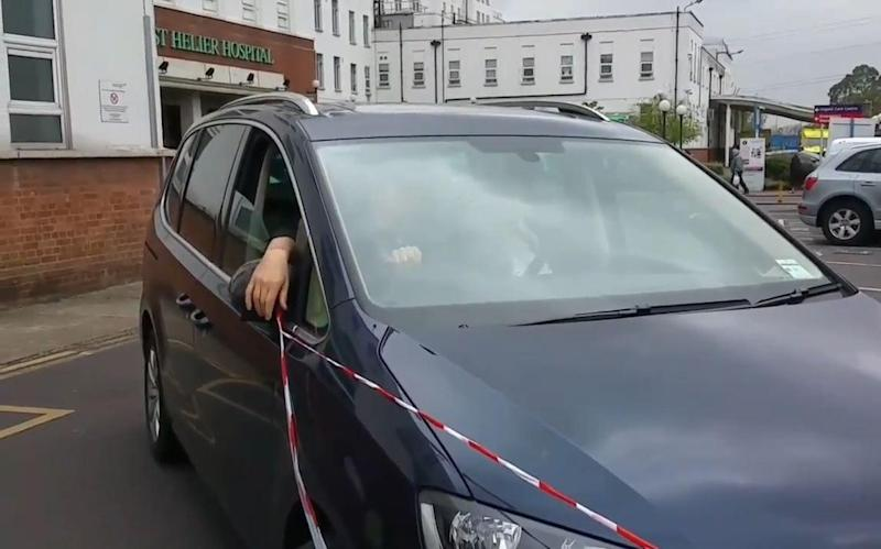 Jeremy Hunt's caught tape on his car as he tried to make a swift exit (Sandra Ash)