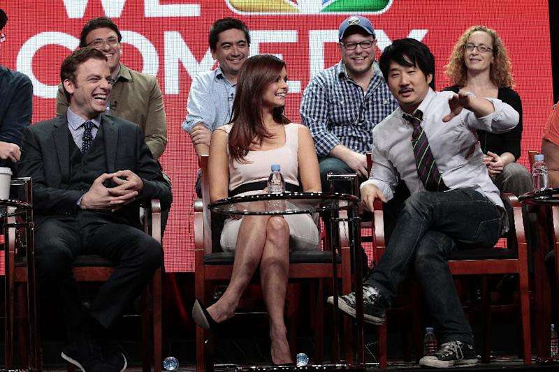 "This Tuesday, July 24, 2012 photo released by NBC shows, front row from left, Justin Kirk, JoAnna Garcia Swisher and Bobby Lee with showrunners for the upcoming comedy ""Animal Practice"" during the NBCUniversal Press Tour in Beverly Hills, Calif. The series premieres Wednesday, Sept. 26, at 8 p.m. EST on NBC. (AP Photo/NBC, Chris Haston)"