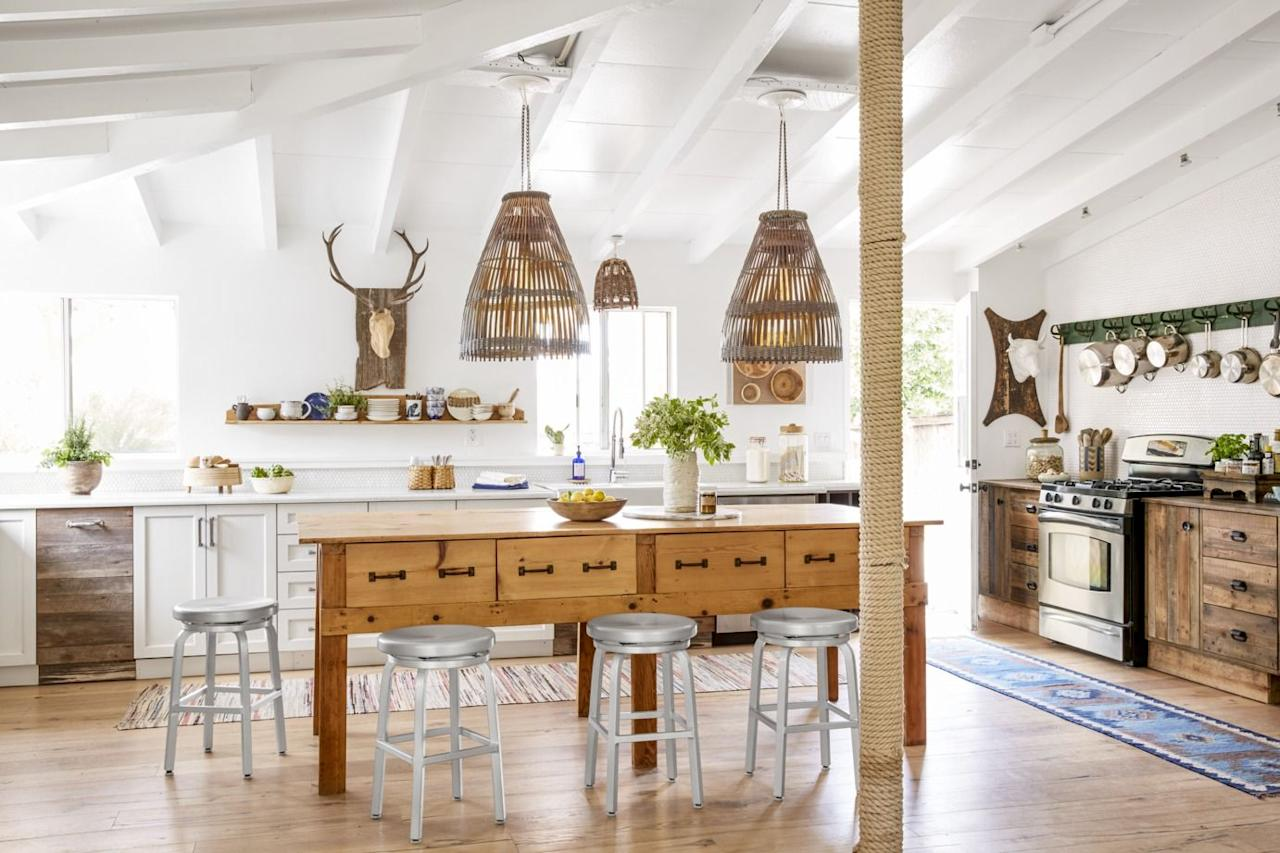 """<p>Good lighting works wonders—for your complexion, your mood, and yes, for your kitchen. And there's no room in the house that begs for an <a href=""""https://www.countryliving.com/home-design/decorating-ideas/g27731686/online-lighting-stores/"""" target=""""_blank"""">excellent lighting</a> plan more than the kitchen. For starters, you need to <em>see</em> what you're doing (knives! fire! hot pans!). But the kitchen is also the <a href=""""https://www.countryliving.com/home-design/decorating-ideas/g1213/kitchen-designs/"""" target=""""_blank"""">heart of the home</a>. It's the spot where you likely start your day (gotta have that cup of joe before listening to, looking at, or speaking to anyone, am I right?). It's  the room where some of the best memories are made—<a href=""""https://www.countryliving.com/food-drinks/g647/holiday-cookies-1208/"""" target=""""_blank"""">baking cookies</a>, preparing a special <a href=""""https://www.countryliving.com/entertaining/g28108095/best-birthday-party-ideas-for-girls/"""" target=""""_blank"""">birthday dinner</a> (with cake!), picking up where you left off with your <a href=""""https://www.countryliving.com/life/g5021/best-friend-quotes/"""" target=""""_blank"""">best friend</a> over a glass of wine. It's a tall order, but the kitchen needs to be practical <em>and</em> look amazing.</p><p>Not to get too dark here (ha!), but the lighting stakes in the <a href=""""https://www.countryliving.com/home-design/decorating-ideas/g4263/rustic-farmhouse-kitchen-ideas/"""" target=""""_blank"""">kitchen</a> are higher than a lot of other home decorating endeavors. To properly illuminate all of the precious moments above, remember that installing light fixtures often requires an electrician (read: more expensive and permanent than, say, throw pillows), so you want to get it right. Lucky for homeowners, lighting options are seemingly endless—pendants, sconces, chandeliers, under counter, recessed, track, lamps—with a gazillion style options and price ranges to boot. </p><p>Playing it safe with a pair of pract"""