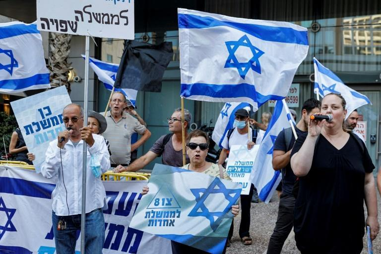 """Supporters of Israel's newly-formed """"change coalition"""" gather during a rally in the Israeli city of Tel Aviv on June 6"""