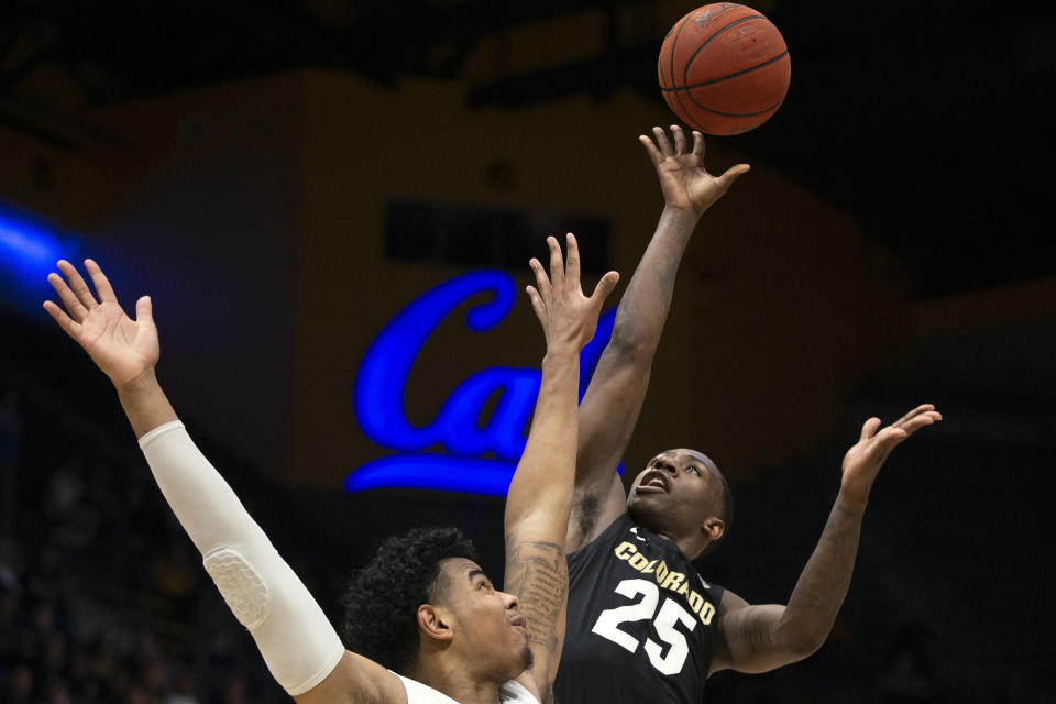 FILE - In this Thursday, Feb. 27, 2020, file photo, Colorado guard McKinley Wright IV (25) shoots over California forward Andre Kelly during the second half of an NCAA college basketball game, in Berkeley, Calif. Wright has decided to return for his senior season after testing out the NBA draft process. He was a member of the All-Pac-12 first team and all-defensive team in a season that was shut down just before the NCAA tournament due to the coronavirus pandemic. (AP Photo/D. Ross Cameron, File)