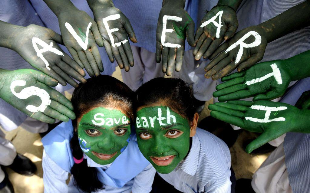 <p>Young students pose with their painted faces to create awareness on World Earth Day at Blossoms Sr. Sec. School, on April 21, 2017 in Patiala, India. Earth Day is an annual event celebrated on April 22. Worldwide, various events are held to demonstrate support for environmental protection. First celebrated in 1970, Earth Day events in more than 193 countries are now coordinated globally by the Earth Day Network. (Photo by Bharat Bhushan/Hindustan Times via Getty Images) </p>