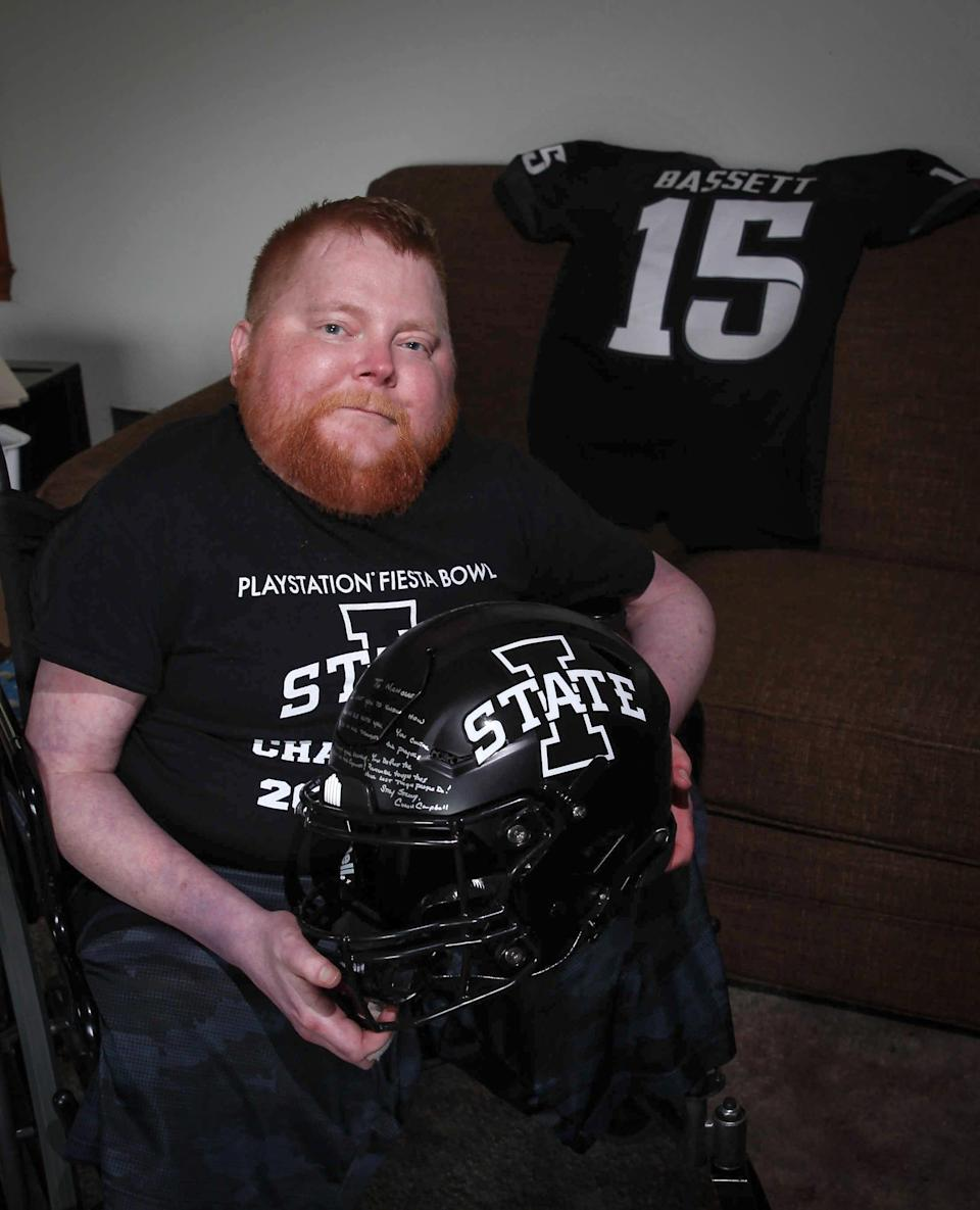 Iowa State Cyclones super-fan Nicholas Bassett of Boone shows off his Cyclones football jersey and helmet, which has a personal message inscribed from Cyclones head football coach Matt Campbell.