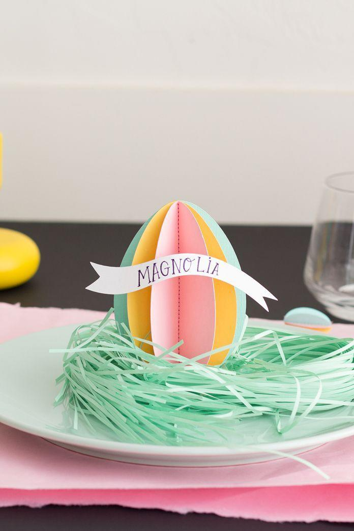"""<p>If you're handy with a sewing machine, these colorful paper place cards can be made in three easy steps.</p><p><em><a href=""""http://thehousethatlarsbuilt.com/2016/03/3d-easter-egg-name-tags.html/"""" rel=""""nofollow noopener"""" target=""""_blank"""" data-ylk=""""slk:Get the tutorial at The House That Lars Built »"""" class=""""link rapid-noclick-resp"""">Get the tutorial at The House That Lars Built »</a></em></p><p><a class=""""link rapid-noclick-resp"""" href=""""https://www.amazon.com/ColorBok-61195B-Smooth-Cardstock-Pastel/dp/B01KG9PAH2?tag=syn-yahoo-20&ascsubtag=%5Bartid%7C10055.g.2217%5Bsrc%7Cyahoo-us"""" rel=""""nofollow noopener"""" target=""""_blank"""" data-ylk=""""slk:BUY SCRAPBOOK PAPER"""">BUY SCRAPBOOK PAPER</a><br></p>"""