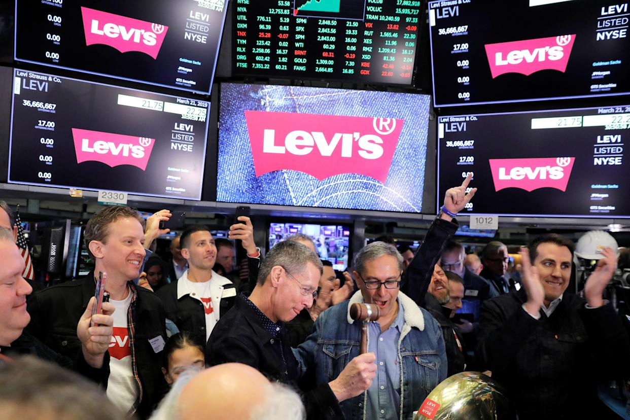Levi Strauss & Co. CEO Chip Bergh rings a bell as CFO Harmit Singh looks on during the company's IPO on the floor of the New York Stock Exchange (NYSE) in New York, U.S., March 21, 2019. REUTERS/Lucas Jackson
