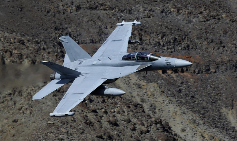 In this Feb. 27, 2017, photo, an EA-18G Growler from China Lake VX-9 Vampire squadron flies through the nicknamed Star Wars Canyon in Death Valley National Park, Calif. Military jets roaring over national parks have long drawn complaints from hikers and campers. But in California's Death Valley, the low-flying combat aircraft skillfully zipping between the craggy landscape has become a popular attraction in the 3.3 million acre park in the Mojave Desert, 260 miles east of Los Angeles. (AP Photo/Ben Margot)