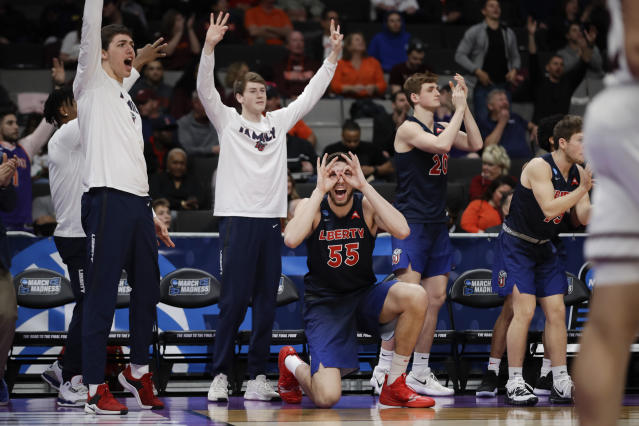 Liberty players celebrate during the second half against Mississippi State in a first-round game in the NCAA mens college basketball tournament Friday, March 22, 2019, in San Jose, Calif. (AP Photo/Ben Margot)