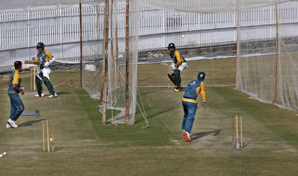 Pakistan player Babar Azam, top right, and Abid Ali, second left, bat during a practice session at the Pindi Cricket Stadium, in Rawalpindi, Pakistan, Thursday, Oct. 29, 2020. The Zimbabwe cricket team is in Pakistan to play three ODIs and three Twenty20 International match series, beginning with the first ODI on Friday. (AP Photo/Anjum Naveed)