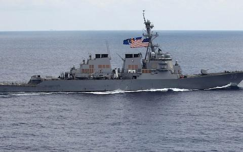 The USS John S. McCain is a guided missile destroyer - Credit: AP