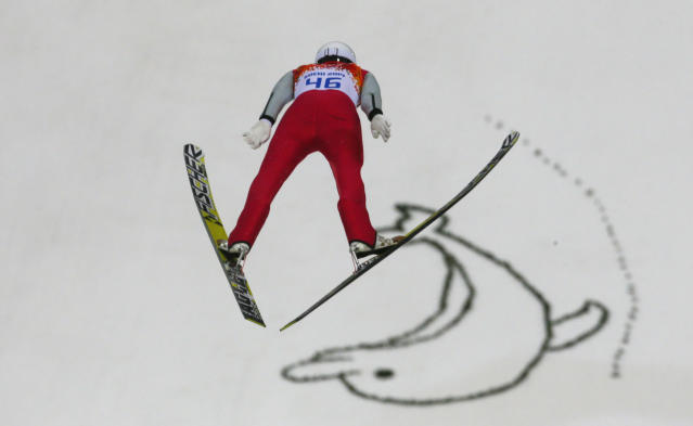 Germany's Eric Frenzel makes his trial jump during the Nordic combined individual Gundersen large hill competition at the 2014 Winter Olympics, Tuesday, Feb. 18, 2014, in Krasnaya Polyana, Russia. (AP Photo/Dmitry Lovetsky)