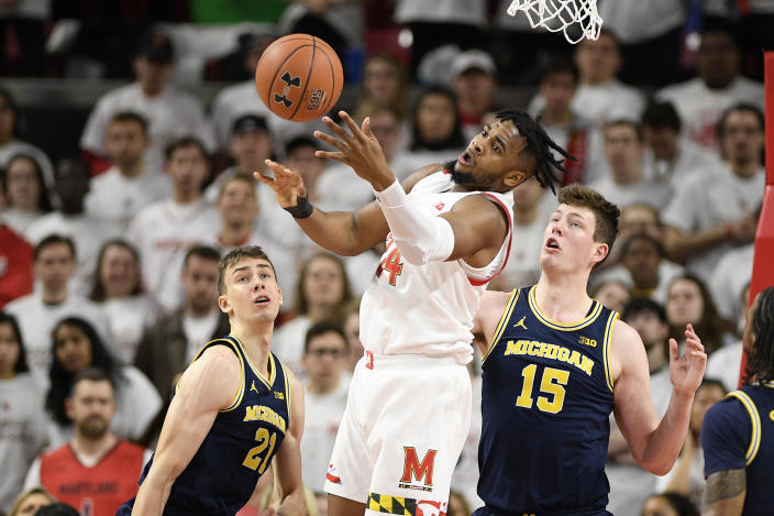 Maryland forward Donta Scott (24) loses the ball next to Michigan guard Franz Wagner (21) and center Jon Teske (15) during the first half of an NCAA college basketball game, Sunday, March 8, 2020, in College Park, Md. Wagner was called for a foul on the play. (AP Photo/Nick Wass)