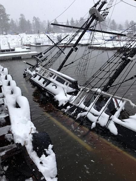 "In this March 1, 2014 photo provided by the Big Bear Visitors Bureau, shows a 43-foot pirate ship tour boat that sank in Big Bear Lake, Calif. The one-third scale 16th century Spanish galleon replica was a prop in the movie ""Time Bandits."" The 27-ton boat has been docked at Holloway Marina, where it was found sunken on Saturday, March,1, 2014. (AP Photo/Big Bear Visitors Bureau)"
