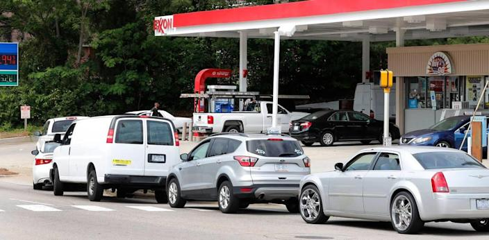 Cars spill onto S. Saunders Street waiting for gas at the Exxon station in Raleigh, N.C., Tuesday afternoon, May 11, 2021.