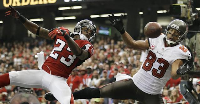 Tampa Bay Buccaneers wide receiver Vincent Jackson (83) misses a catch in the end zone as Atlanta Falcons cornerback Robert Alford (23) during the second half of an NFL football game, Sunday, Oct. 20, 2013, in Atlanta. (AP Photo/David Goldman)