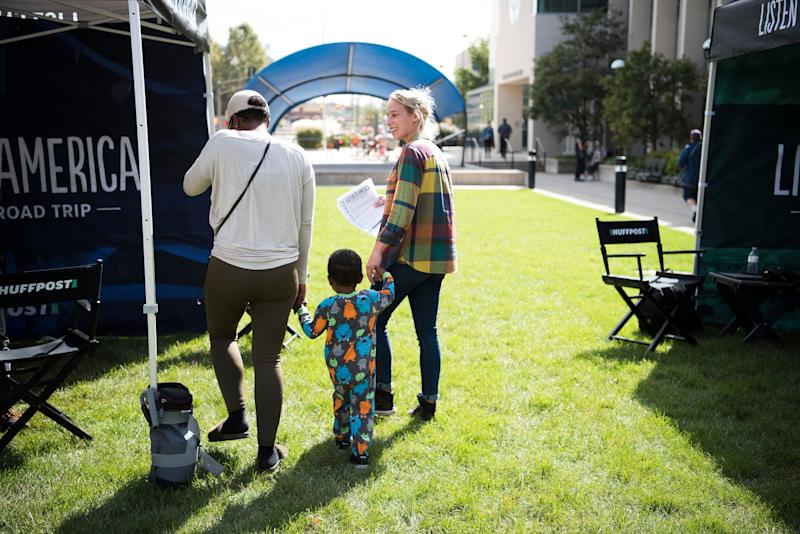 Alanna Vagianos walks Janora Hutt and her son TJ to the tent for a video interview.