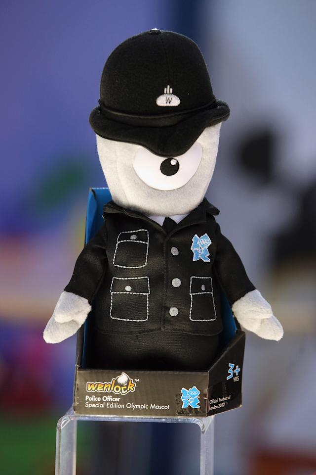 LONDON, ENGLAND - JANUARY 24:  Wenlock, a mascot of the London 2012 Olympic Games, dressed a police officer on display at the 2012 London Toy Fair, at Olympia Exhibition Centre on January 24, 2012 in London, England. The annual fair, which is organised by the British Toy and Hobby Association, brings together toy manufacturers with retailers from around the world.  (Photo by Oli Scarff/Getty Images)