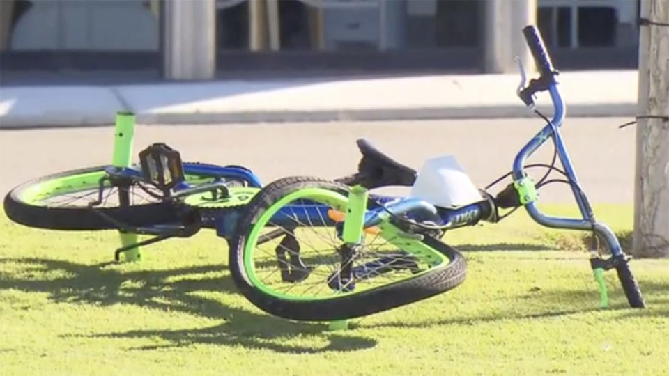 The boy's bike, pictured here after he was struck while riding to school.