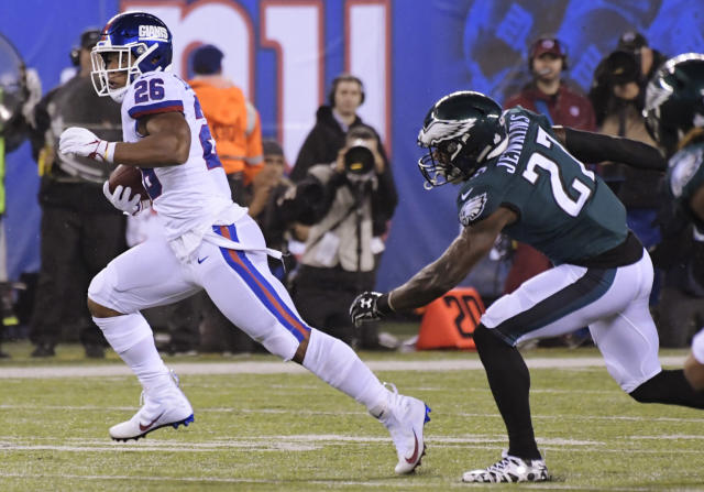 New York Giants running back Saquon Barkley (26) runs away from Philadelphia Eagles' Malcolm Jenkins (27) and Jalen Mills (31) during the first half of an NFL football game Thursday, Oct. 11, 2018, in East Rutherford, N.J. (AP Photo/Bill Kostroun)